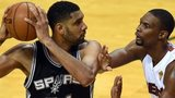 San Antonio's Tim Duncan (left) keeps the ball away from Miami's Chris Bosh