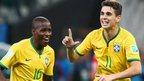 Players celebrate Brazil's goal