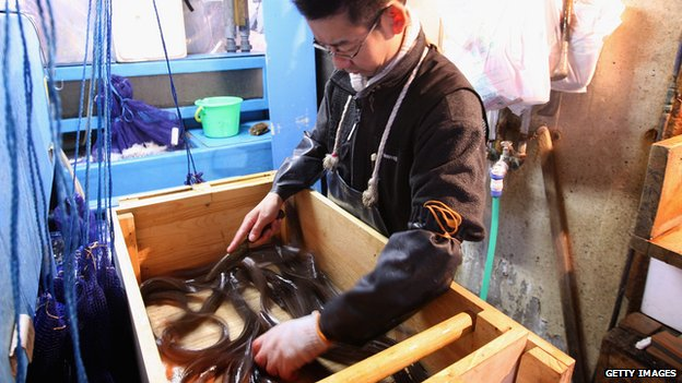 A worker kills eels at Tsukiji Fish Market on 30 October, 2008 in Tokyo, Japan