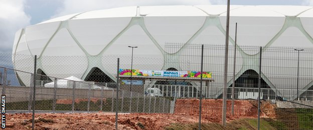 The area around Arena Amazonia shows work remains undone ahead of England's opening game.