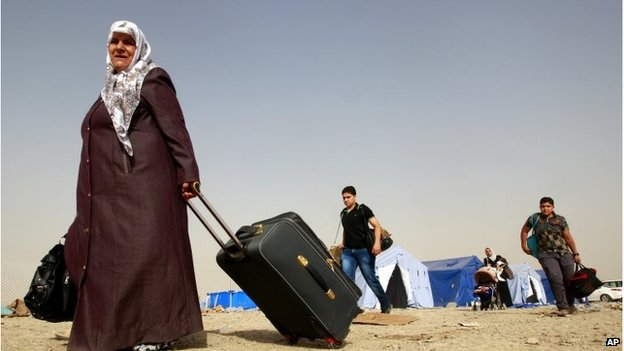 Refugees fleeing Mosul arrive in Irbil on 12 June