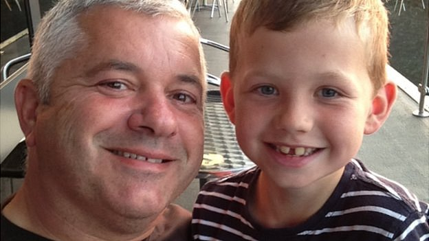 Pc Neil Smith and his son Adam