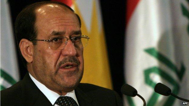 Iraqi Prime Minister Nouri Maliki speaks during a joint press conference with Kurdish regional president Massoud Barzani in the northern Iraqi Kurdish city of Arbil (9 June 2014)