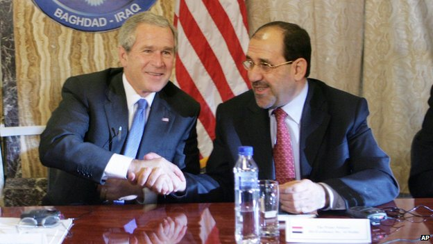 President Bush, left, shakes hands with Iraqi Prime Minister Nouri al-Maliki, right, following their teleconference with members of the U.S. And Iraqi Cabinet members at the U.S. Embassy in Baghdad, Iraq, Tuesday (13 June 2006)