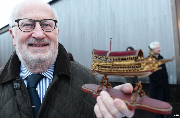 Giorgio Orsoni posing with a model boat during a visit to France (15 February 2014)