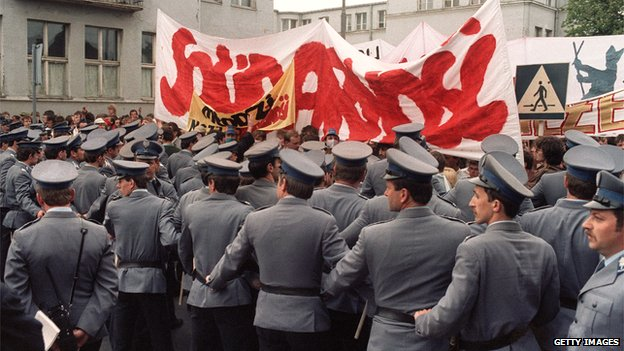 Polish policemen blocking members of the Solidarity trade union during a rally, June 1987