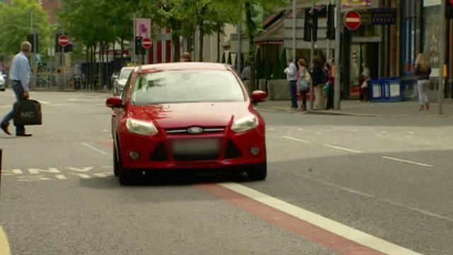 Car in bus lane