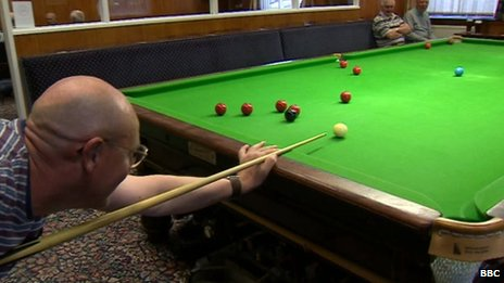 Conservative club members in Seaham playing and watching snooker