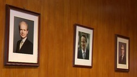 Pictures of Conservative party leaders on a wall