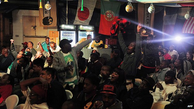 Kenyan football fans cheer as Brazil scores their first goal in a pub in Nairobi, Kenya - 12 June 2014
