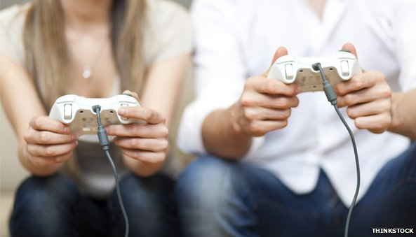 Woman and man playing videogames