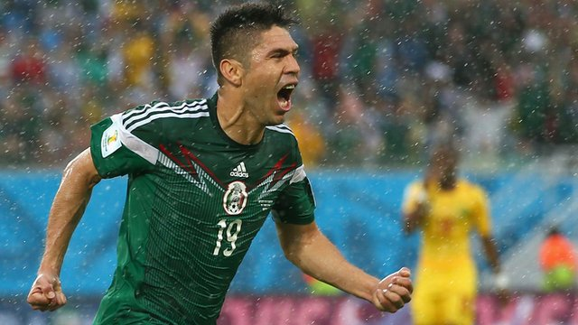 World Cup 2014: Mexico's Oribe Peralta celebrates winner