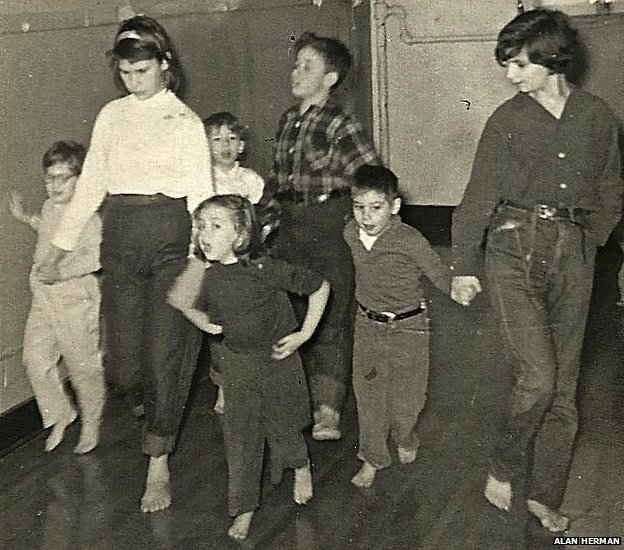 Reggie Nadelson (in white shirt) and friends caring for the younger children