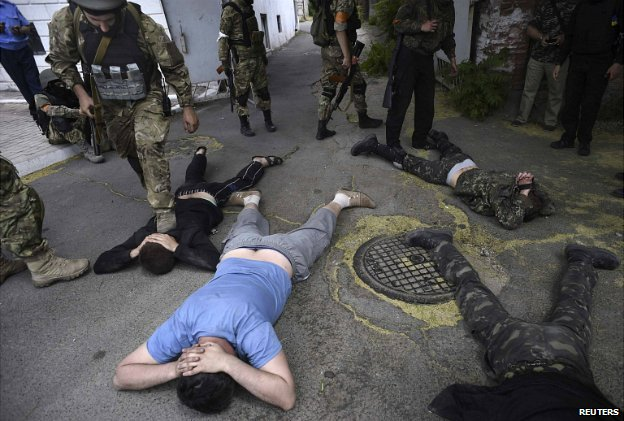 Ukrainian troops detain men after retaking the port city of Mariupol - 13 June 2014