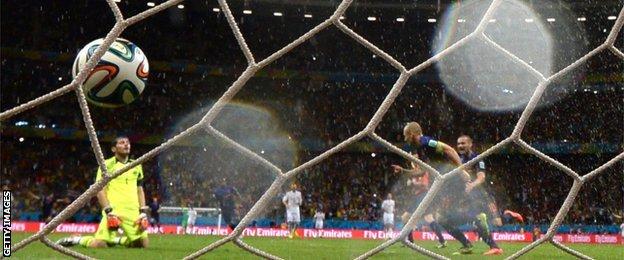 Netherlands forward Arjen Robben scores against Spain in his side's 5-1 win