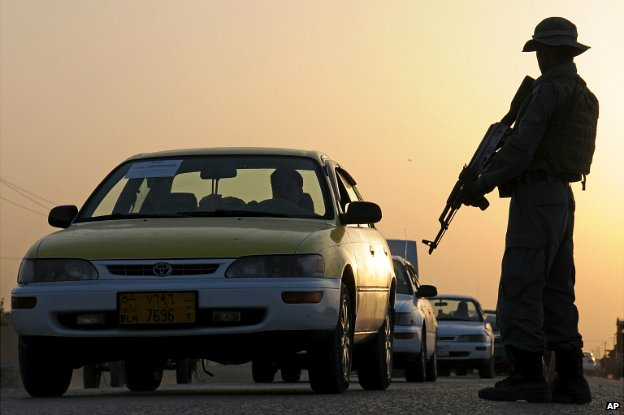 Afghanistan security forces stand guard in a street in Mazar-i-Sharif, north of Kabul - 13 June 2014