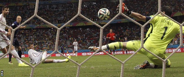 Iker Casillas of Spain concedes a goal to Netherlands