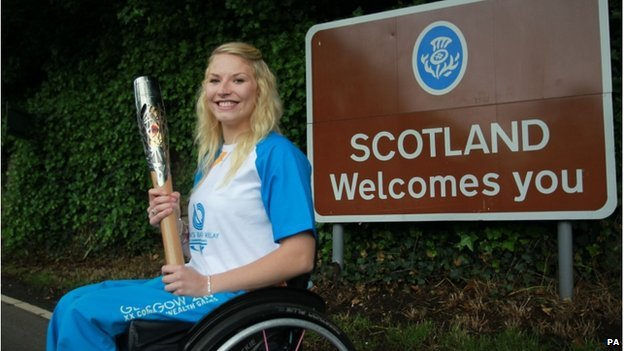 "Batonbearer Samantha Kinghorn carrying the Queen""s Baton through Coldstream"
