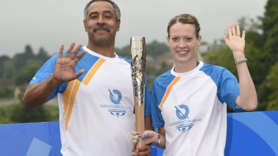 Triple gold medallist Daley Thompson hands over to Scottish athlete Eilidh Child