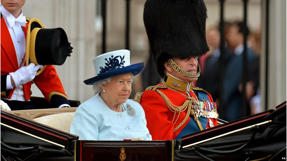 Queen Elizabeth II and the Duke of Edinburgh leave Buckingham Palace in a horse drawn carriage to attend Trooping the Colour on 14 June 2014