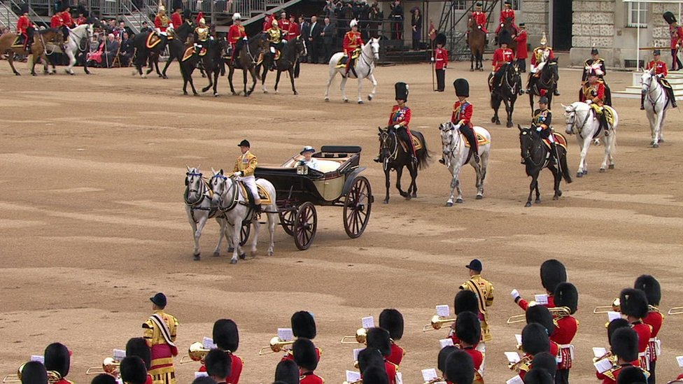 The Queen begins to inspects troops from her carriage at Trooping the Colour on 14 June 2014