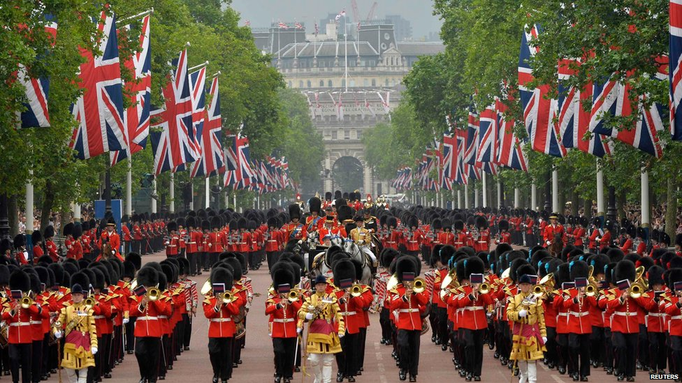 The Queen returns to Buckingham Palace in the annual Trooping the Colour ceremony on 14 June 2014