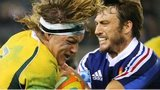 Australia captain Michael Hooper is tackled by France wing Maxime Medard