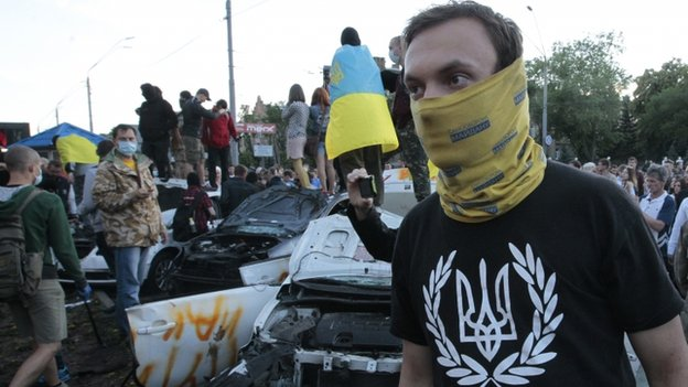 Ukrainian protesters destroy cars near the Russian embassy in Kiev, 14 June