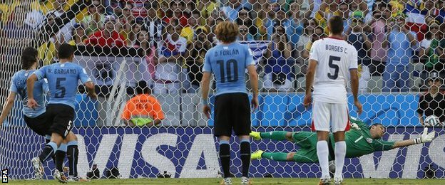 Edinson Cavani (left) puts Uruguay in front against Costa Rica with a clinical penalty