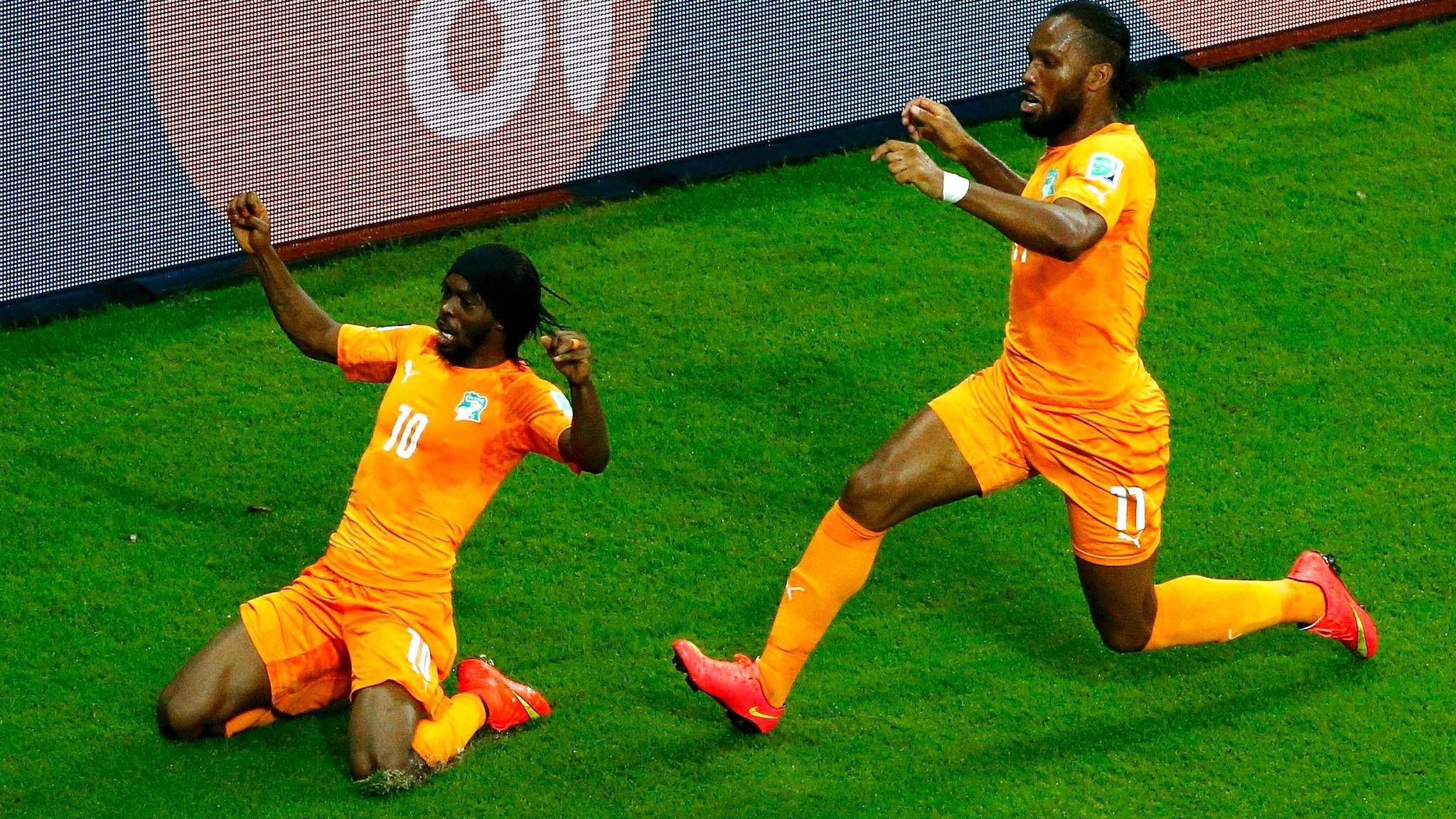 Ivory Coast's Gervinho and Didier Drogba celebrate