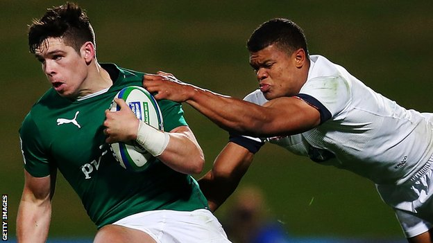 Alex Wootton of Ireland is tackled by Nathan Earle of England