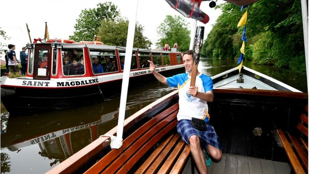 Alastair Hay carries the baton on the canal at Linlithgow