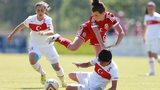 Wales' Angharad James is tackled by Turkey's Hanife Demiryol