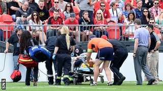 Scotland flanker Alasdair Strokosch is stretchered off against Canada