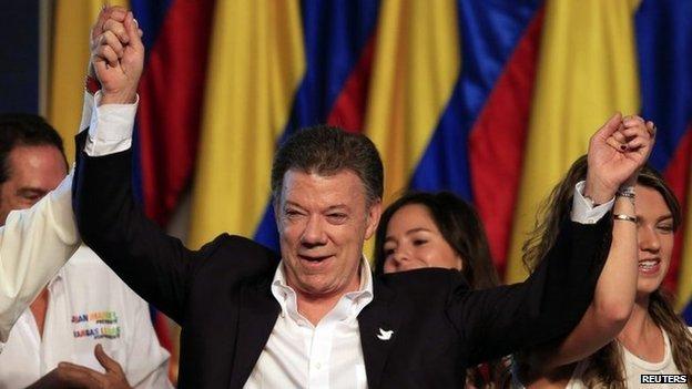 Juan Manuel Santos celebrates victory