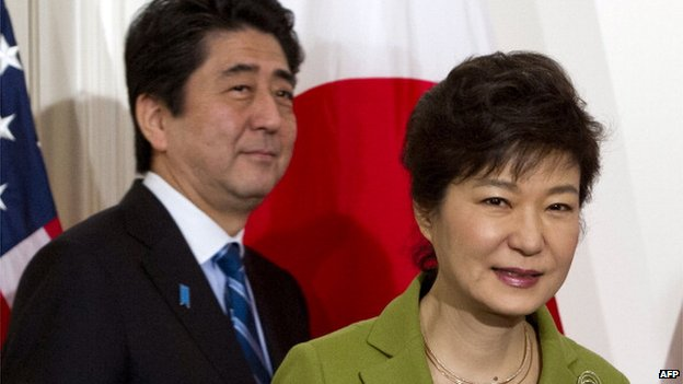 South Korean President Park Geun-hye and Japanese Prime Minister Shinzo Abe arrive for a trilateral meeting with the US president at the US ambassador's residence in The Hague on 25 March, 2014