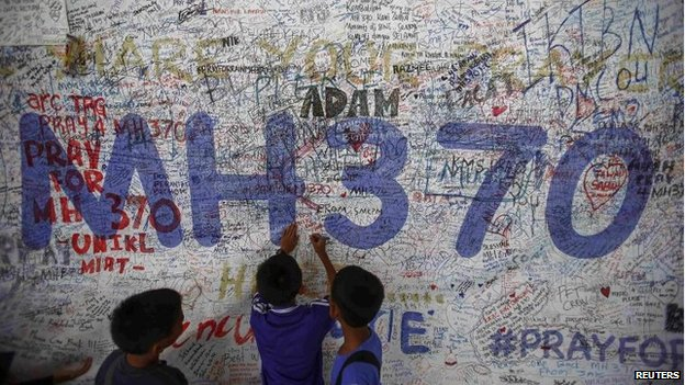 Children write messages of hope for passengers of missing Malaysia Airlines Flight MH370 at Kuala Lumpur International Airport (KLIA) outside Kuala Lumpur June 14