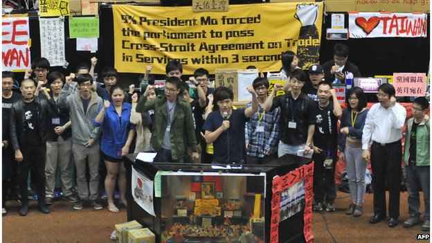 Students protest leaders shout slogans during an occupy protest against a contentious trade agreement with China inside the Parliament building in Taipei on 7 April.