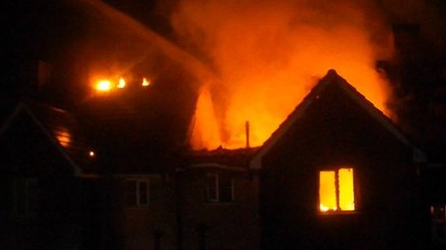 A neighbour filmed the the fire on his mobile phone while his family looked on