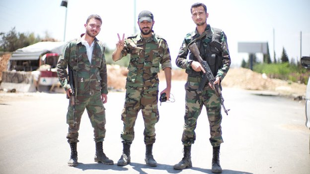 Syrian army soldiers at crossing point to eastern side of Aleppo