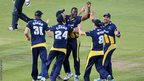 Darren Sammy celebrates with his Glamorgan team-mates after taking a wicket against Kent