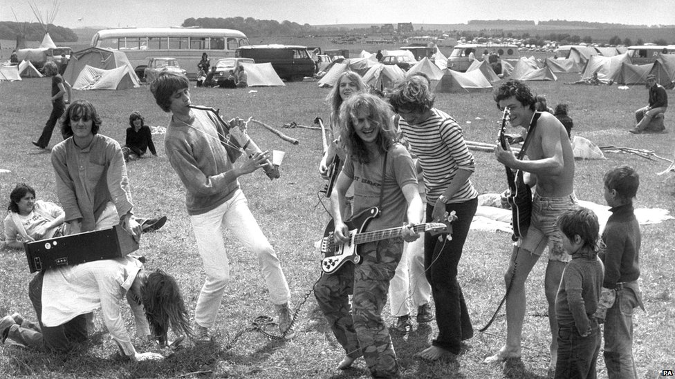 A group of musicians provide at entertainment at the Stonehenge Free Festival in 1980