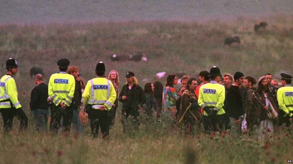 Police confront uninvited visitors within a few hundred yards of Stonehenge in 1998