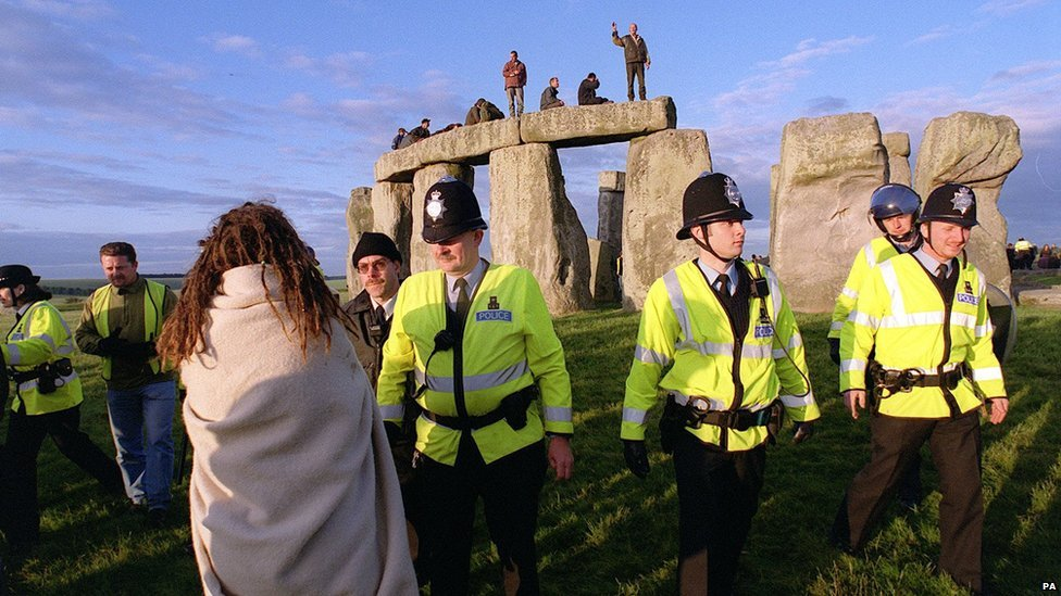 Police move to evict revellers at Stonehenge, Wiltshire, after a large number of people converged on the site during the celebration of the summer solstice in 1999.