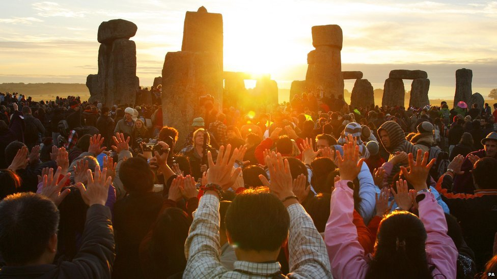 Revellers gather at the World Heritage site at Stonehenge in Wiltshire in 2010 to watch the sunrise during the summer solstice, marking the longest day of the year.