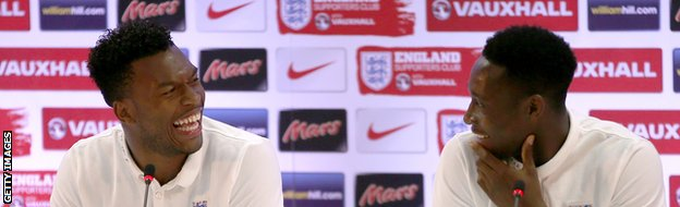 Daniel Sturridge and Danny Welbeck share a joke during an England press conference