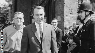 Jimmy Greaves, dressed in suit and tie, walks to Wembley to attend the 1966 World Cup final