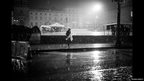 A displaced man walks across Plaza Bolivar in the rain
