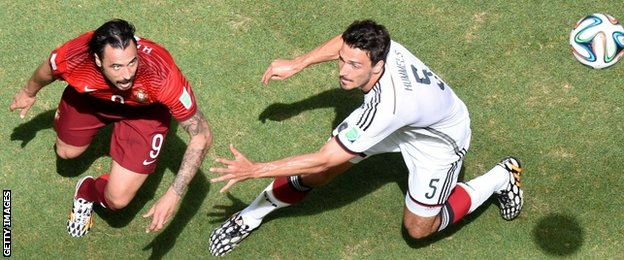 Germany defender Mats Hummels (right) is challenged by Portugal forward Hugo Almeida