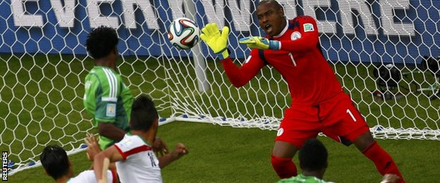 Nigeria's goalkeeper Vincent Enyeama makes a save during their 2014 World Cup Group F soccer match against Iran